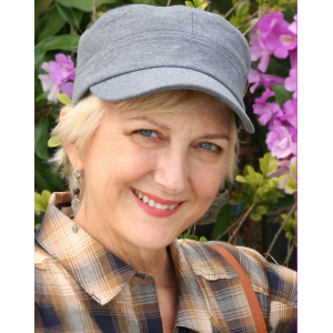 Middle aged blonde woman in a gray cap.
